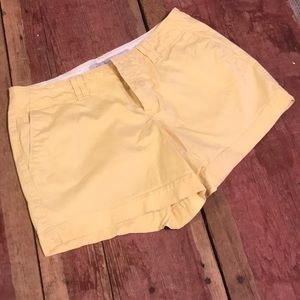 Yellow old navy shorts back pocket flaps